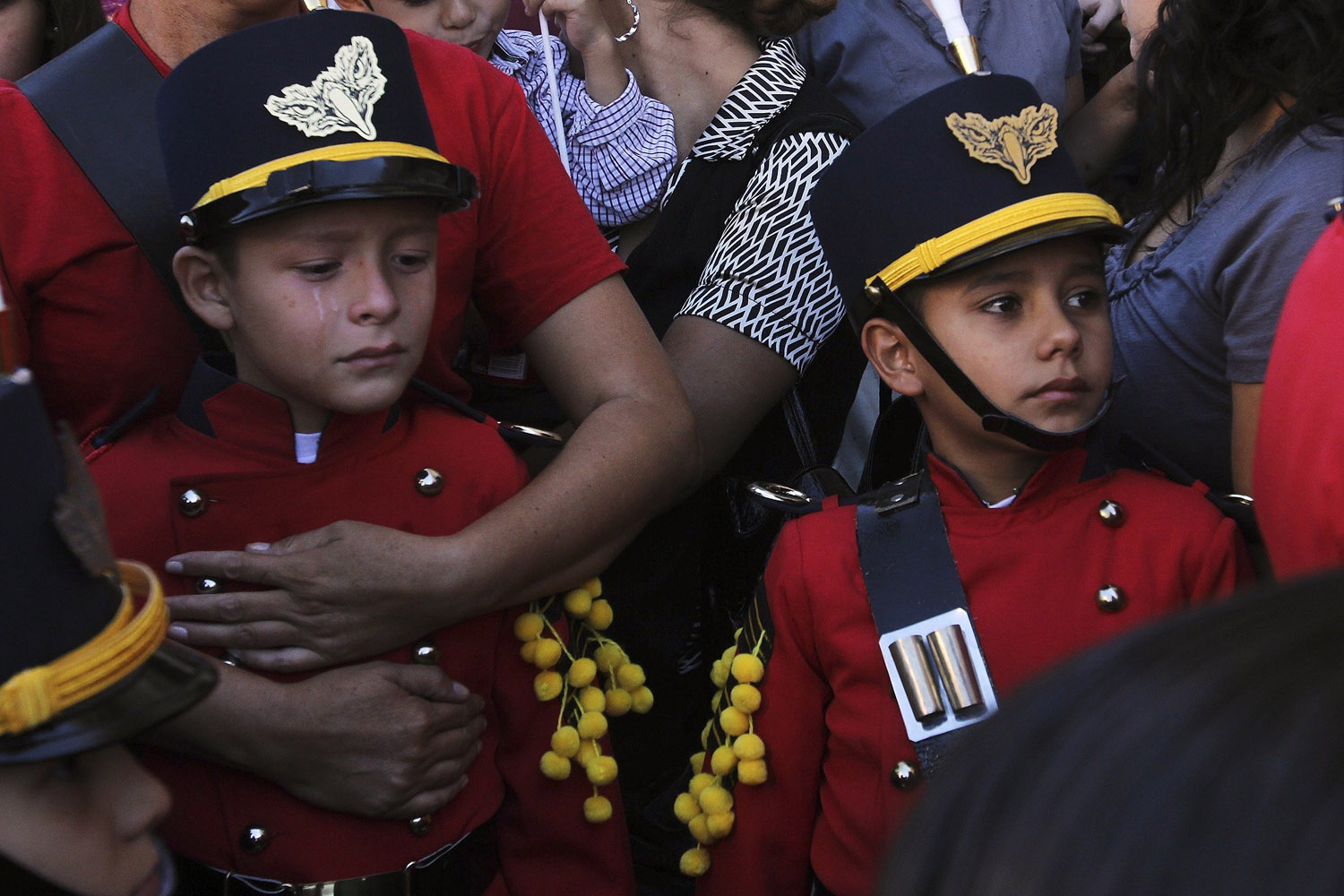 Oct. 7, 2013. A young musician cries after a mass for a 12-year-old boy and his father, victims of a monster truck accident, at a church in Chihuahua, Mexico.