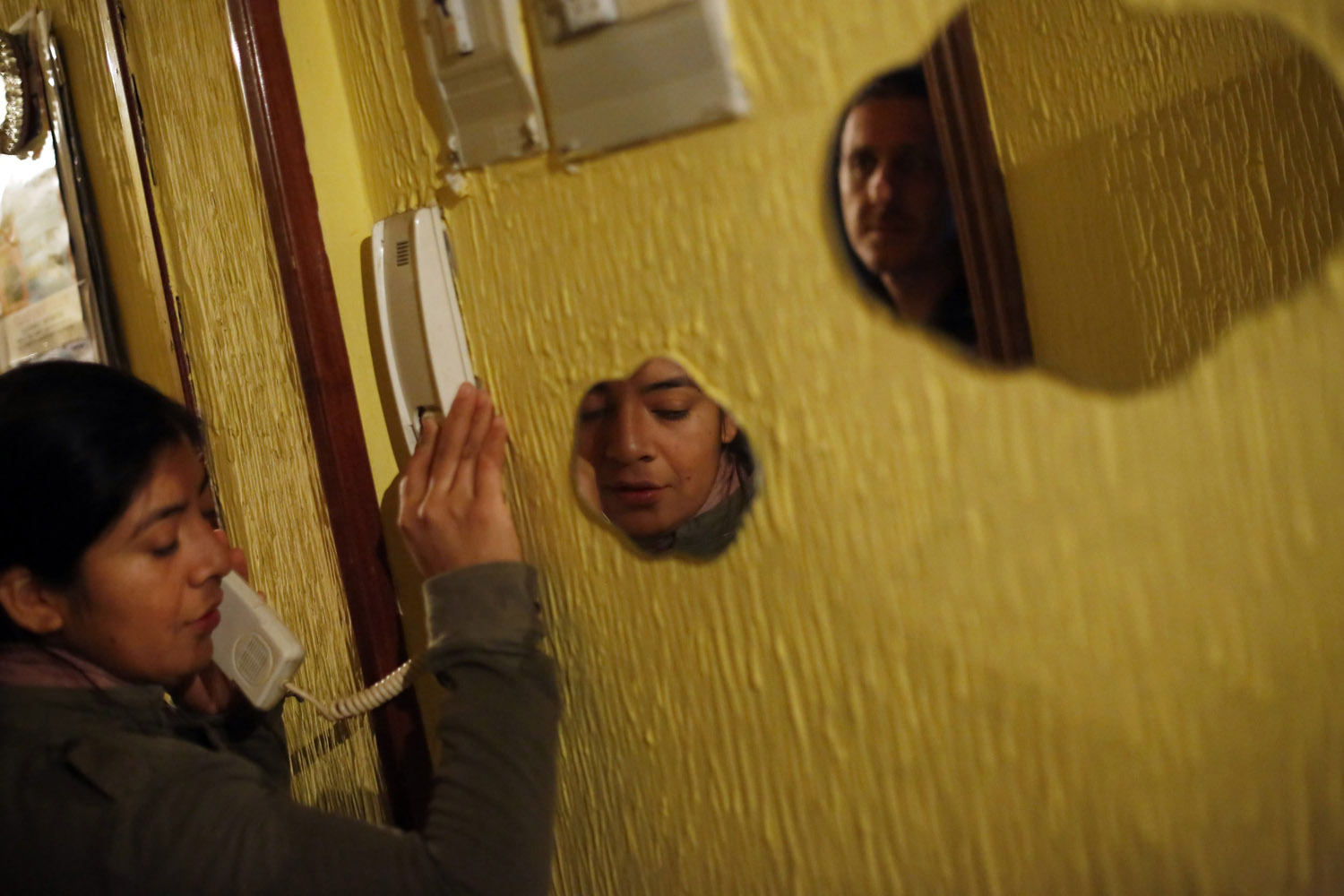 Oct. 8, 2013. Maira Jumbo, who holds dual citizenship in Spain and Ecuador, answers a phone call before learning that her family's eviction had been suspended, at her home in Madrid.