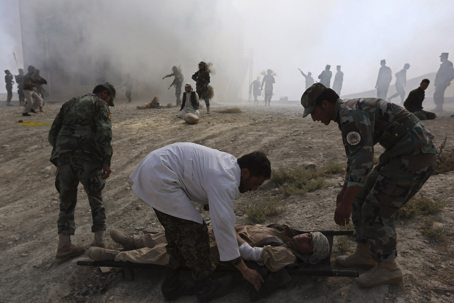 Oct. 8, 2013. Afghan National Army (ANA) officers take part in a training exercise at the Kabul Military Training Center (KMTC) in Kabul.