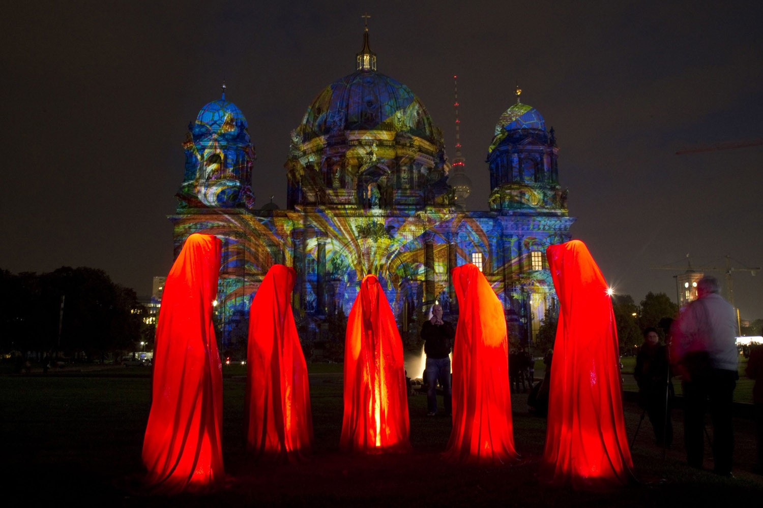 Oct. 9, 2013. People look at a light installation at the Berlin Cathedral during the opening day of the  Festival of Light  show in Berlin.