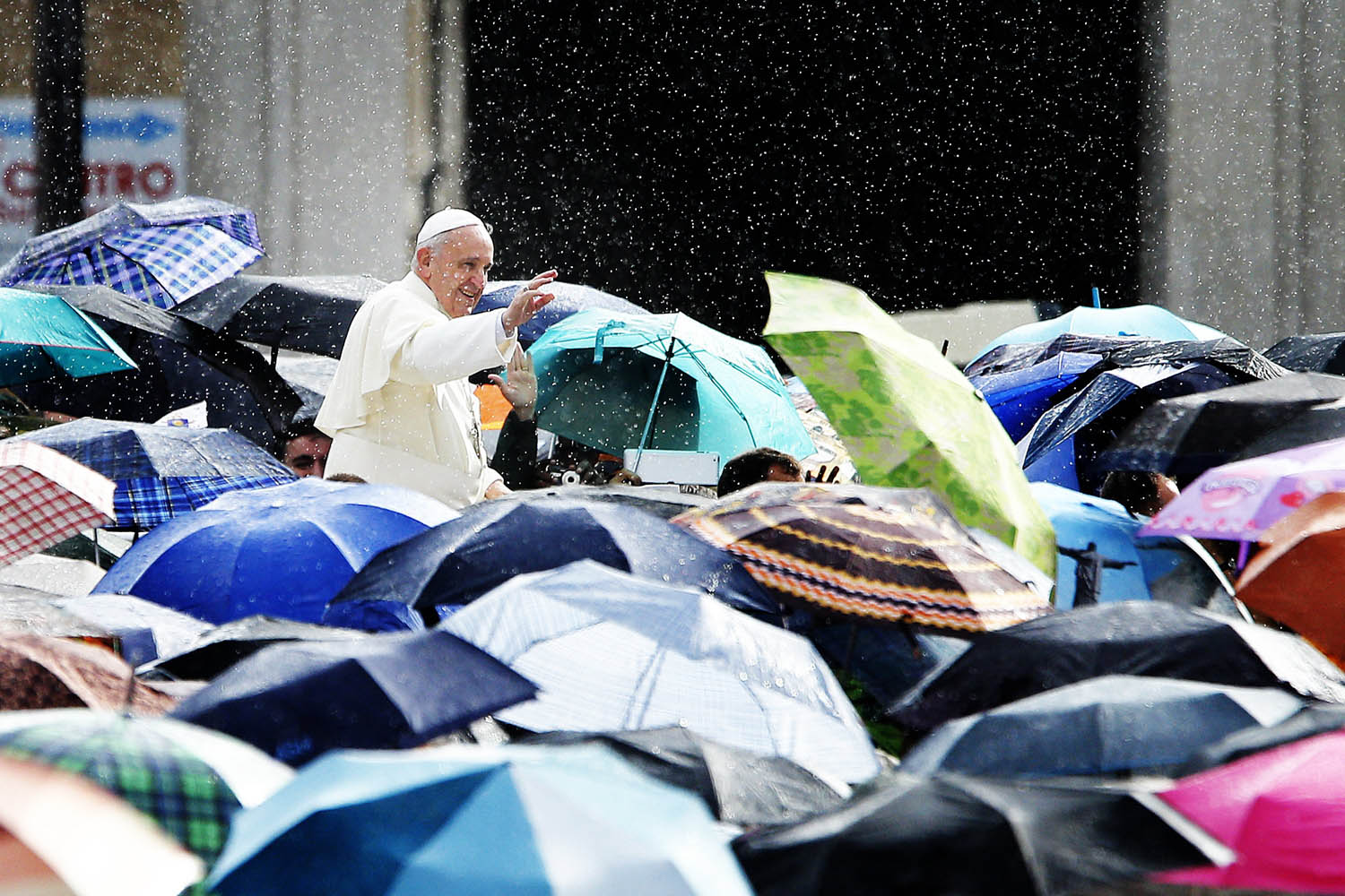Oct. 9, 2013. Pope Francis greets the faithful under the rain during the General Audience in St Peter's Square at the Vatican.