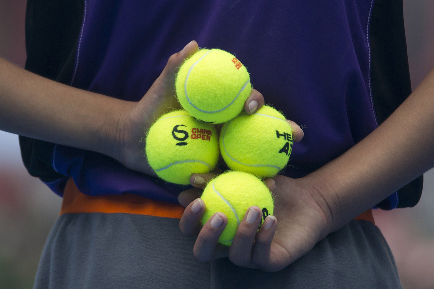 Oct. 5, 2013. A ball boy holds tennis balls before the semifinal match between Rafael Nadal of Spain and Tomas Berdych of the Czech Republic at the China Open tennis tournament at the National Tennis Stadium in Beijing.