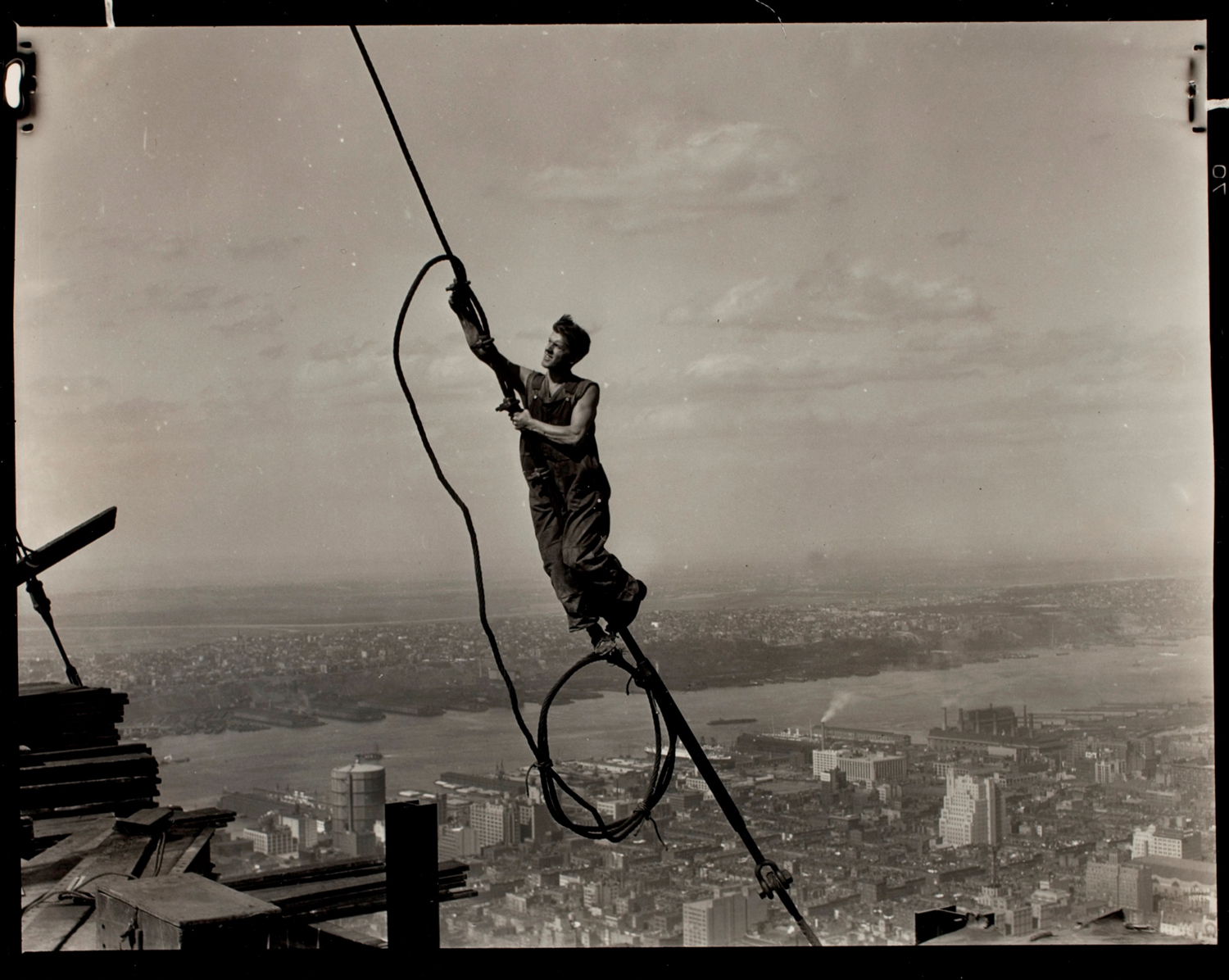Exhibition. Lewis Hine,  The Future of America: Lewis Hine's New Deal Photographs.  International Center of Photography, New York, New York. October 4, 2013 - January 19, 2014. Pictured: Icarus Atop Empire State Building, 1931.