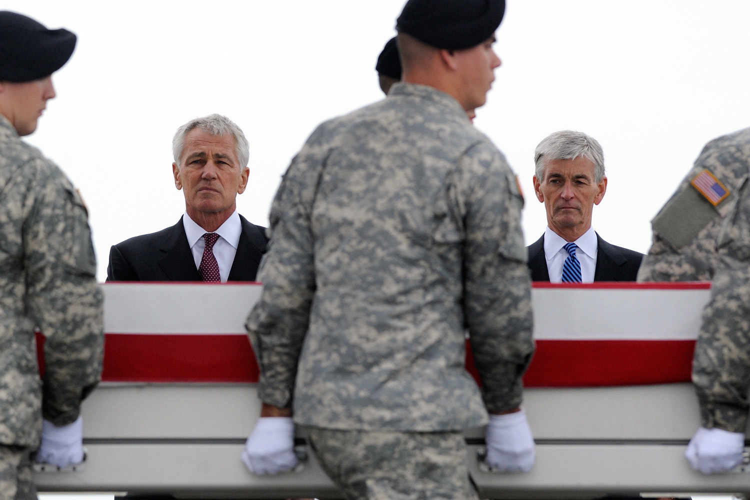 Oct. 9, 2013. Defense Secretary Chuck Hagel, left, and Army Secretary John McHugh, right, watch an Army carry team move a transfer case containing the remains of Pfc. Cody J. Patterson at Dover Air Force Base, Del.