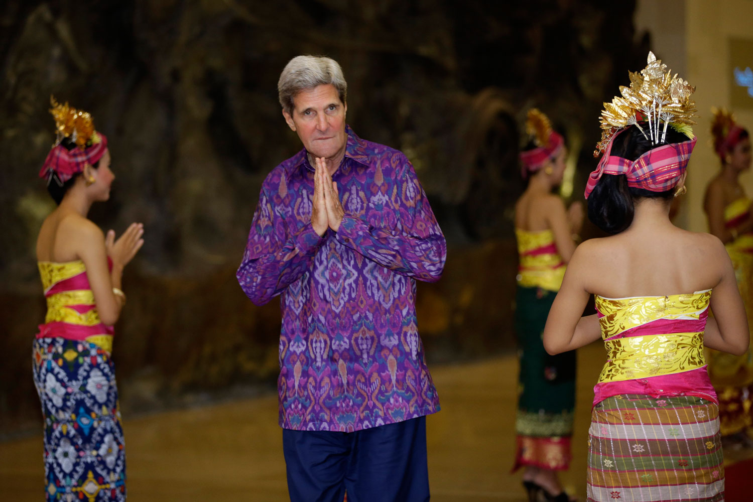 Oct. 7, 2013. U.S. Secretary of State John Kerry, wearing 'endek', a traditional Balinese woven fabric, arrives at a dinner for leaders of the Asia-Pacific Economic Cooperation forum in Bali.
