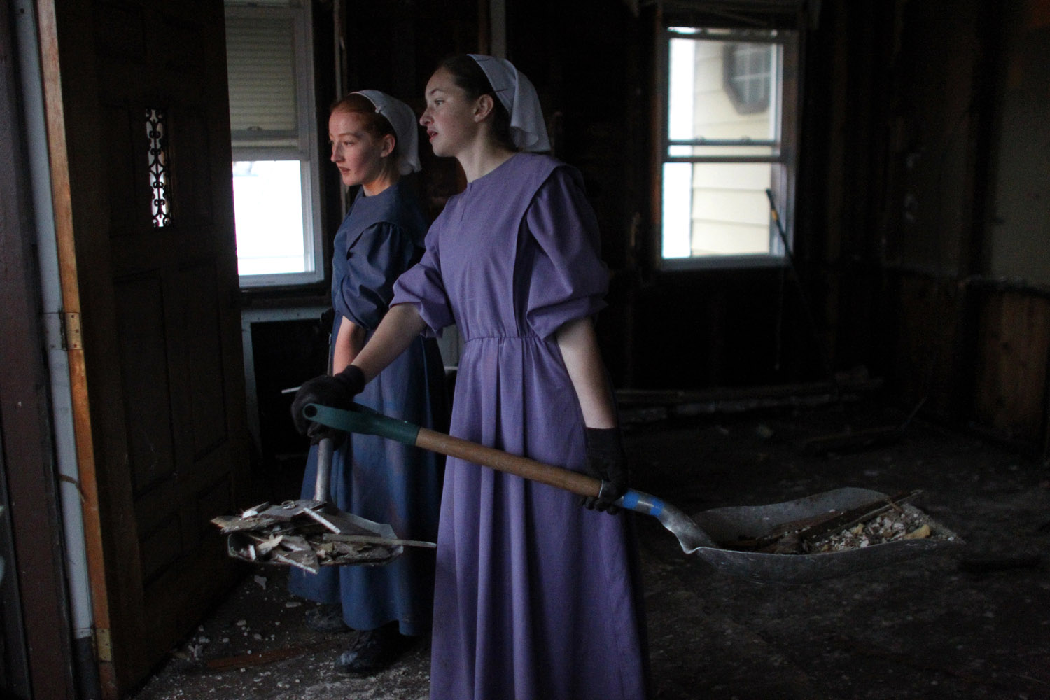Amish women from Greenville, P.A., clear out a house on 2nd Street in Union Beach,                               N.J., Nov. 19, 2012