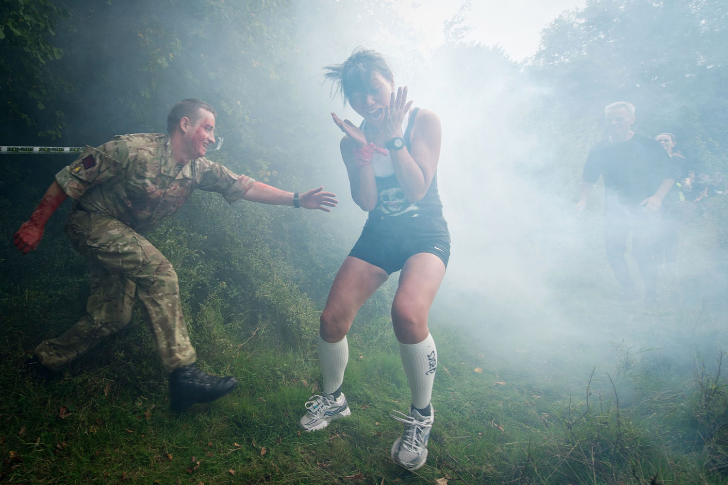Oct. 5, 2013. A participant is terrified by a  zombie  soldier in a forest section during one of Britain's biggest horror events, the  Zombie Evacuation Race  at Carver Barracks near Saffron Walden, England.