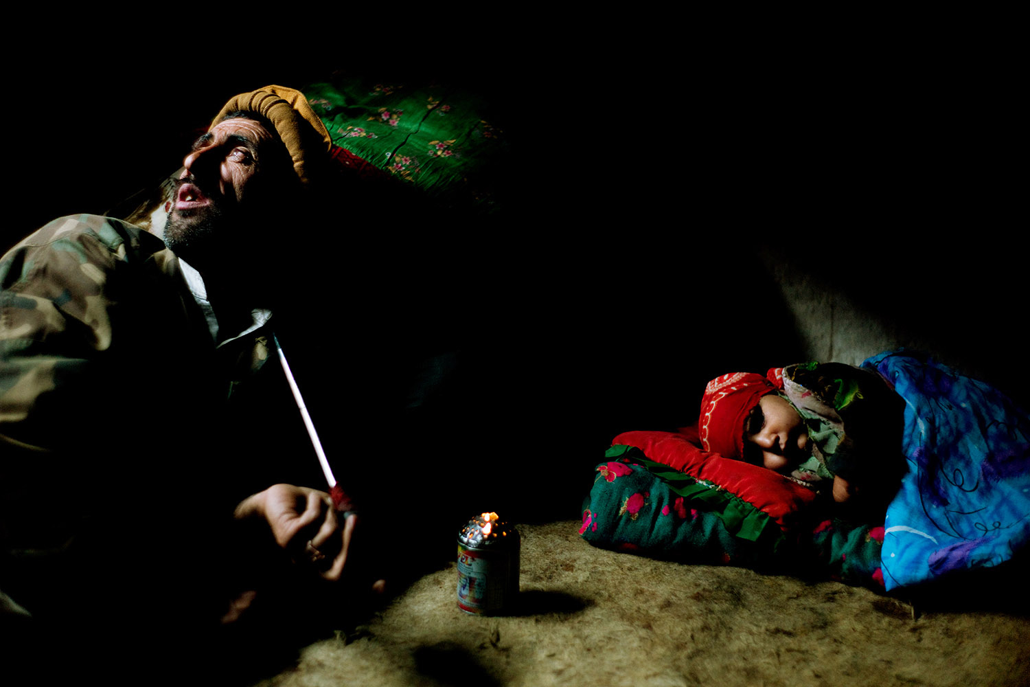 Book. Nur. La Luce Nascosta dell'Afghanistan, by Monika Bulaj. Electa: October, 2013. Pictured: This village in Badakshan lacks aspirin and antibiotics. In many part of Afghanistan, the only medicine to kill the pain and stop the hunger is opium, which is also given to children.