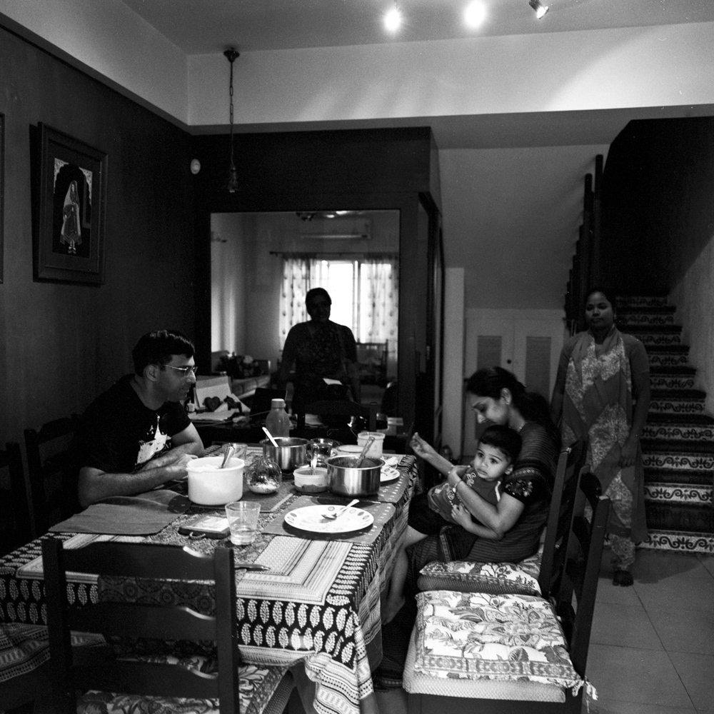 Anand and his family have lunch at home in Chennai with their babysitter and cook. October 2013.