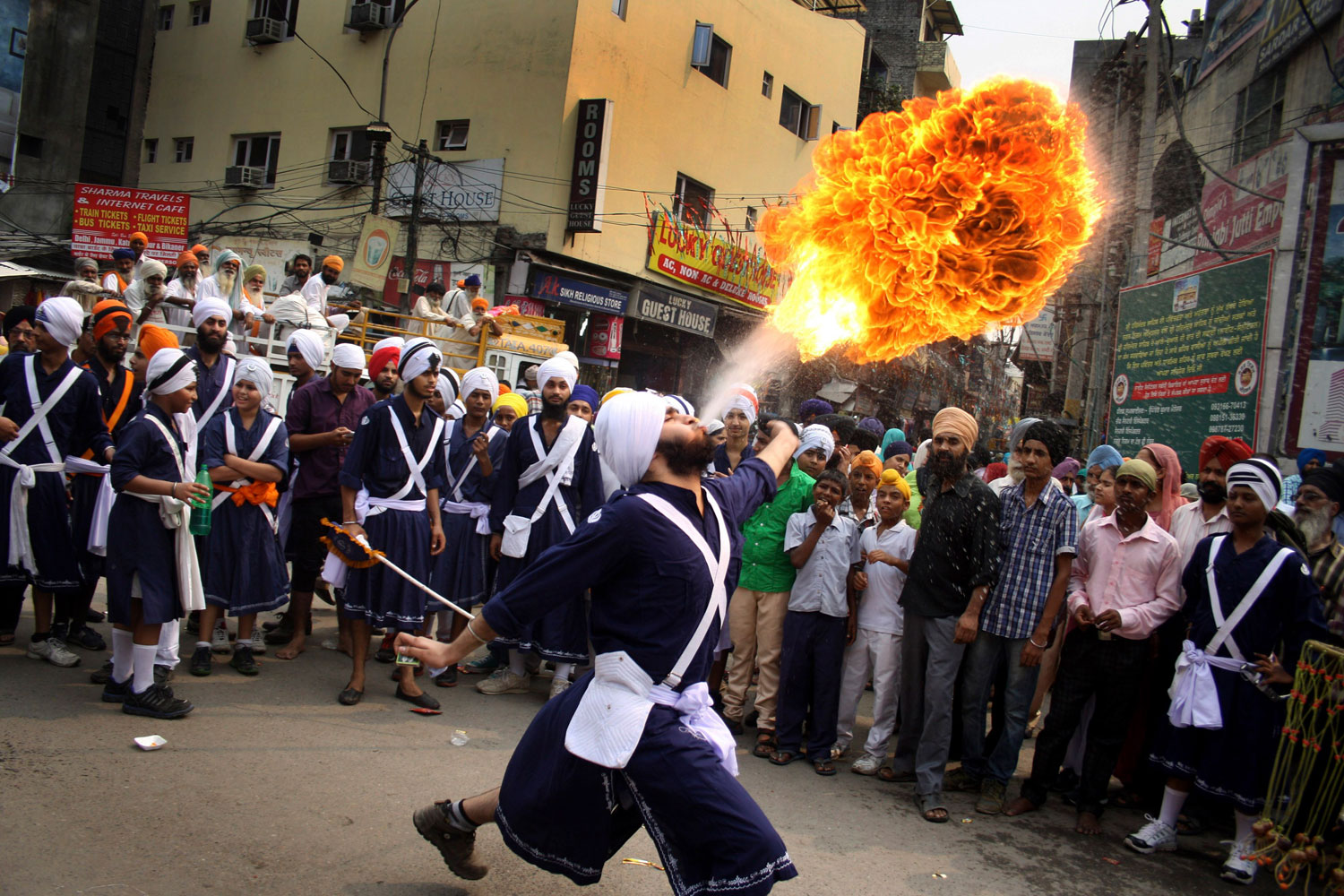 Oct. 8, 2013. A Sikh youth breathes fire during a religious procession on the eve of Guru Ram Das's birthday in Amritsar, India. Ram Das was the fourth of the ten gurus of Sikhism.