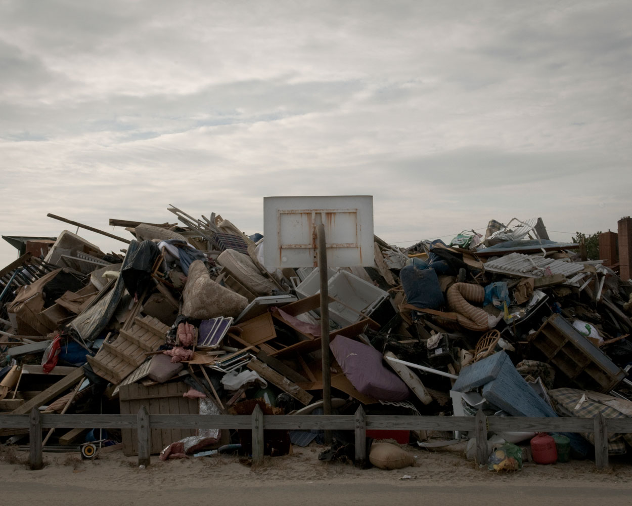 Debris stored next to a basketball hoop in Breezy Point, Queens, N.Y., Nov. 10, 2012