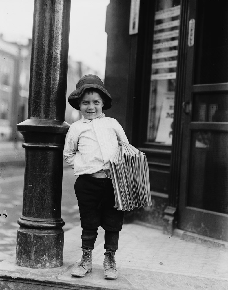 "George Okertich, newsboy, 5 years old, St. Louis, Missouri, 1910. Newsboy. Little Fattie. Less than 40 inches high, 6 years old. Been at it one year. May 9th, 1910. —Hine's original captionGeorge (officially Slavko Ocretic) was born in Croatia (Yugoslavia) on April 22, 1905, which means that he was actually only five years old when he was photographed by Hine.""Uncle George was 15 when he went to work. He was a mail carrier. He was called the Singing Mailman. He loved to sing. He had a nice voice. He sang everywhere. When his mother died, he sat in the funeral parlor and sang for all of us. I remember once that my grandmother sent me to the corner tavern to get him, and he sat me up on top of the bar, and I had to sing with him."" —Niece of George Okertich"