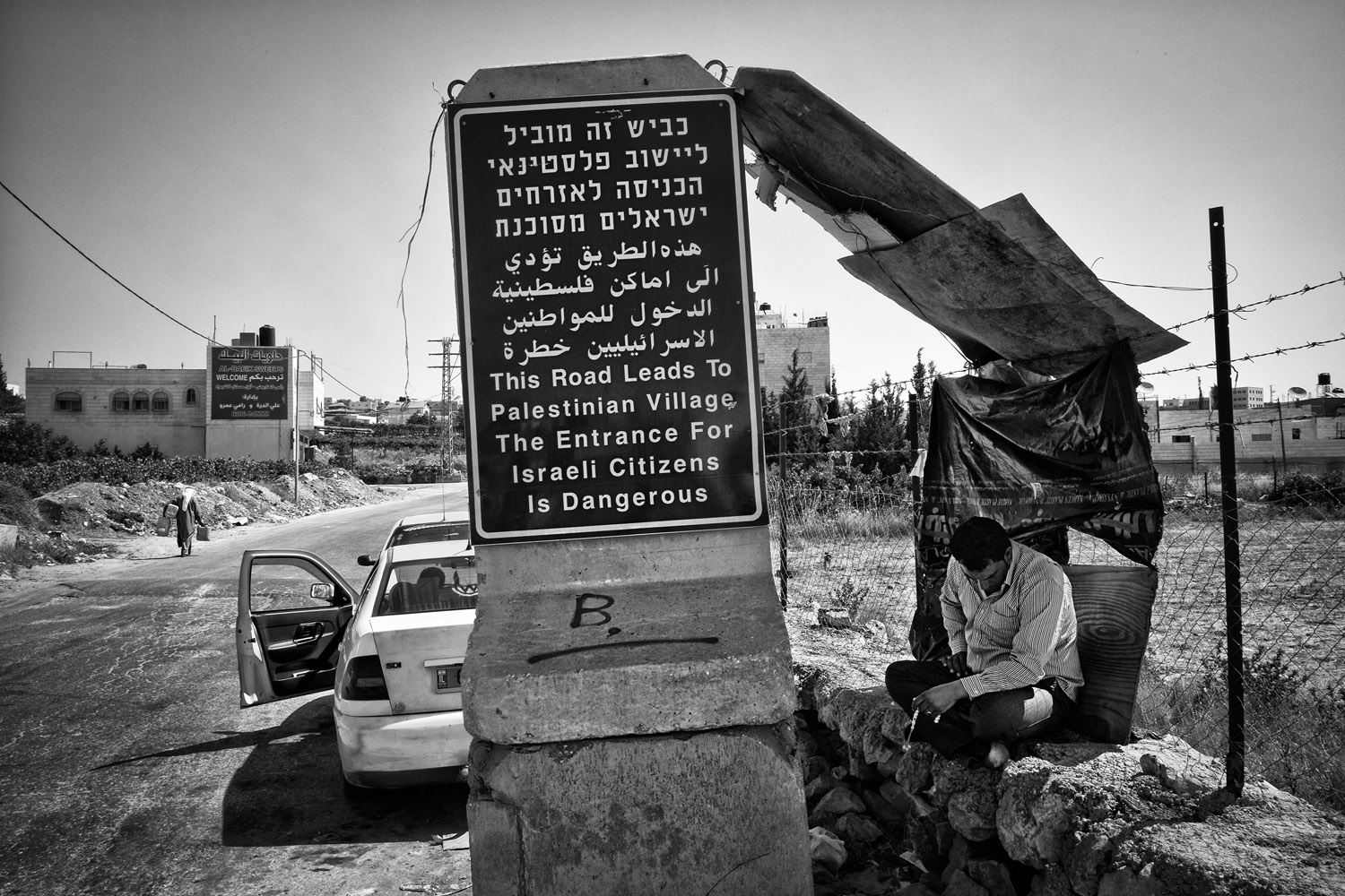 A road sign at the entrance of the village in Sayr, West Bank, June 22, 2013.