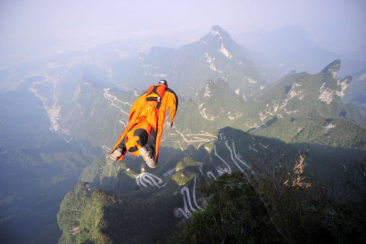 Oct. 8, 2013. Hungarian wingsuit flyer Victor Kovats jumps into a valley in Tianmen Mountain National Forest Park in Zhangjiajie, central China's Hunan province.