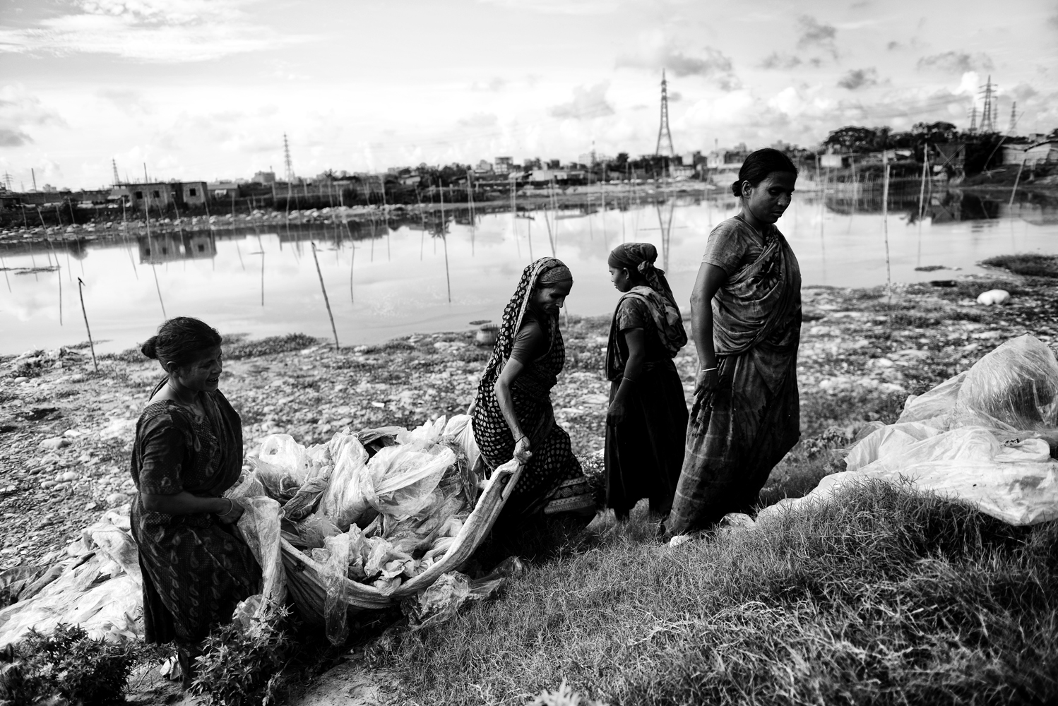 Women washing clothes in the lake which has been polluted by tanneries and chemical products in Hazaribagh, Dhaka, Bangladesh.