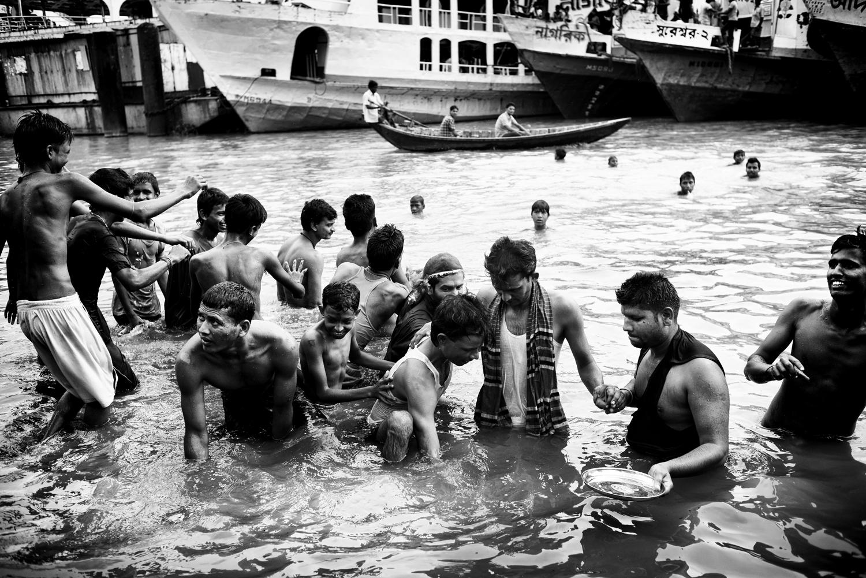 Locals in the Buriganga River                               take part in a Hindu ceremony, Dhaka, Bangladesh.