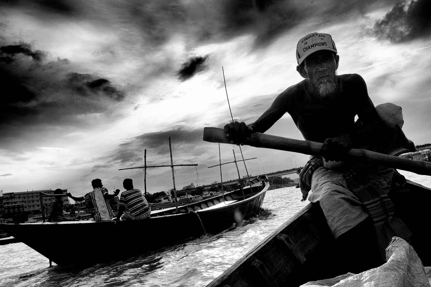 Thousands of small                               boats are used by locals to cross the river daily, Dhaka, Bangladesh.
