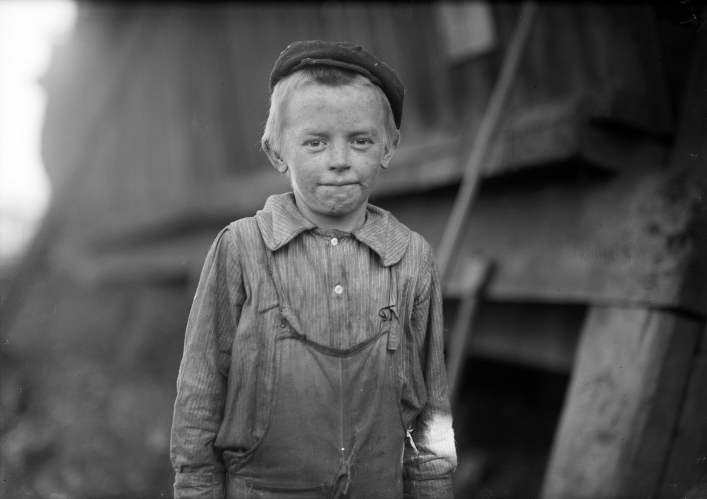 "Lonnie Cole, doffer at cotton mill, 11 years old, Birmingham, Alabama, 1910.  OUR BABY DOFFER  they called him. Has been doffing for some months. When asked his age, he hesitated, then said,  I'm Twelve.  Another young boy said  He can't work unless he's twelve.  Child Labor regulations were conspicuously posted in the mill. —Hine's original caption ""He was just a very easygoing person. When he was around, all of the kids loved to be with him, because he would play with them and joke with them. My Uncle Lon was not a man who made a great impact. He was just an ordinary man. I find it really exciting that, in a way, because of your story about him, he has made an impact.  —Niece of Lonnie Cole"