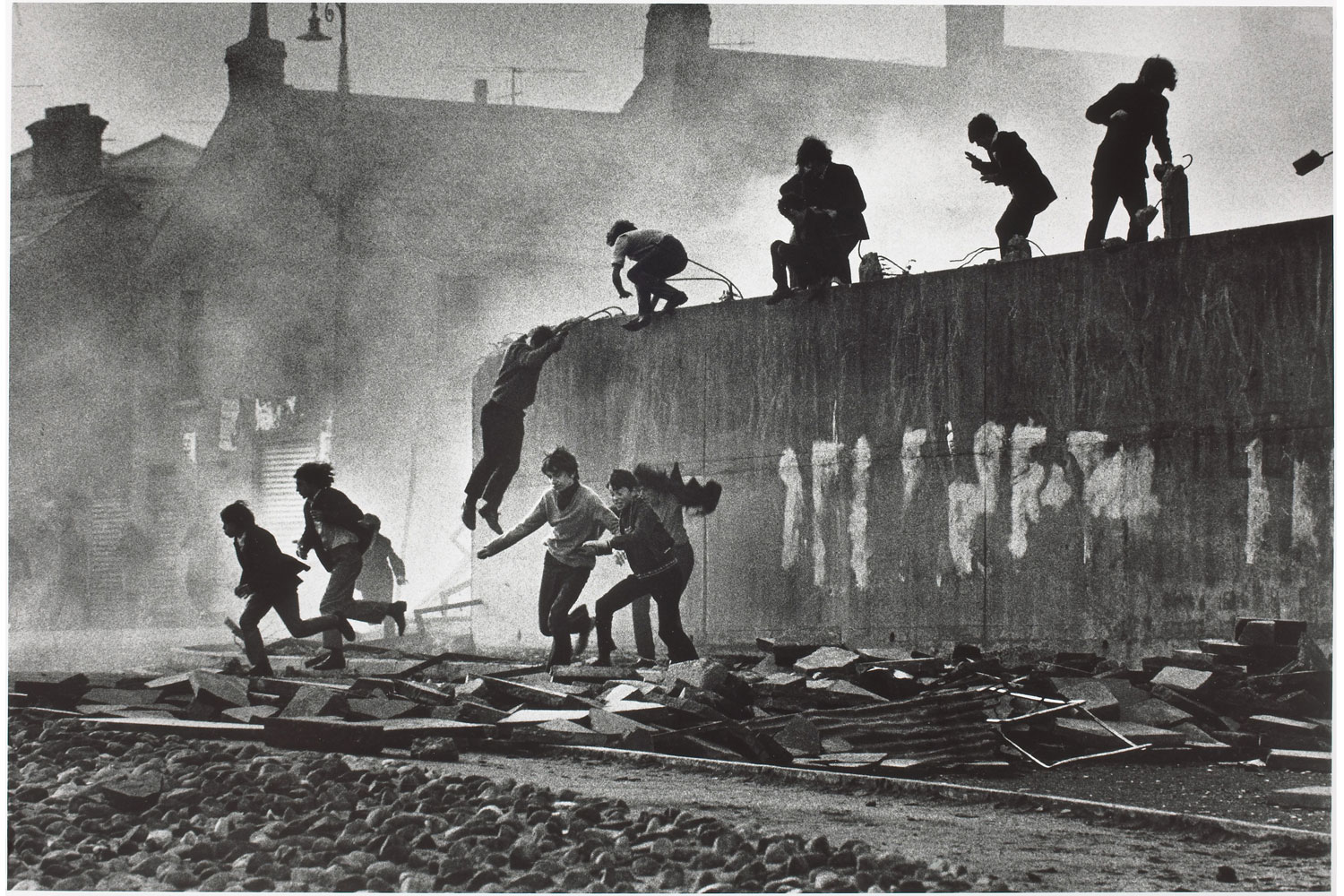 Exhibition.  Don McCullin: A Retrospective.  Winnipeg Art Gallery, Winnipeg, Canada. November 1, 2013 - January 12, 2014. Pictured: Catholic youth escaping a CS gas assault in the Bogside, Londonderry, Northern Ireland, 1971.