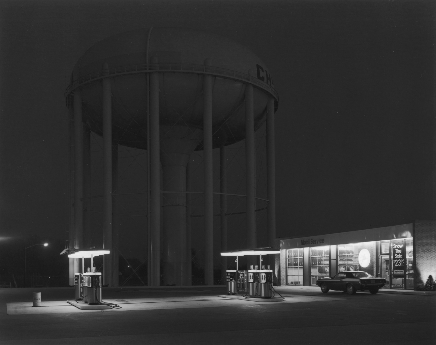 Exhibition. George Tice,  60 Years of Photography.  Nailya Alexander Gallery, New York, New York. Over view until November 23, 2013. Pictured: Petit's Mobil Station, Cherry Hill, NJ, 1974.
