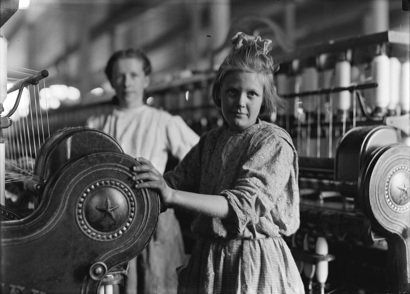 "Sadie Barton, spinner in cotton mill, 13 years old, Lancaster, South Carolina, 1908. A typical Spinner Lancaster Cotton Mills, S.C.  —Hine's original caption""Mom may have been faced with things we will never know, but it did not destroy her spunk and strength. She was very much with me the day I learned about her picture. No words could ever explain the depth of emotion I felt when I first saw it, knowing my mother was the beautiful girl in that photograph."" —Daughter of Sadie Barton"