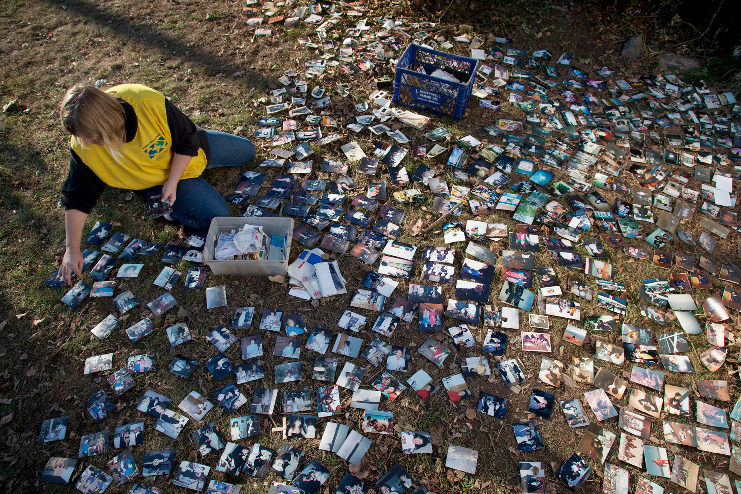 Salvaging photographs in New Dorp,                               Staten Island, N.Y., Nov. 11, 2012