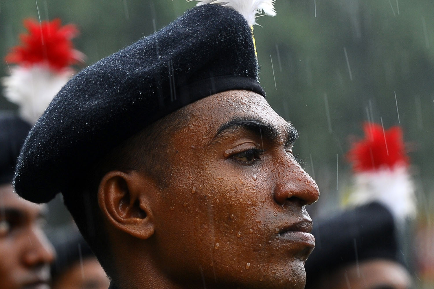 Oct. 10, 2013. A Sri Lankan soldier stands at attention as rain falls during the army's 64th anniversary and Army Day ceremony in Colombo.