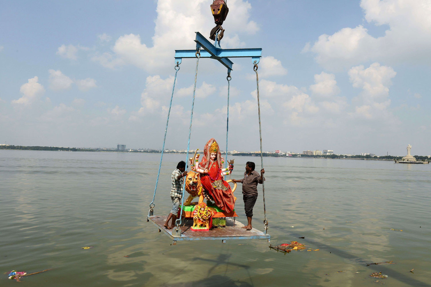 Oct. 14, 2013. Indian workers immerse an idol of Hindu goddess Durga in the Hussainsagar lake on the occasion of the Dussehra-Vijaya Dashami Festival in Hyderabad. The annual Hindu festival worships the Goddess Durga, who symbolizes power and triumph of good over evil in Hindu mythology.