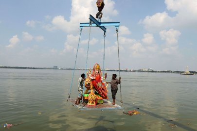 Indian workers immerse an idol of Hindu goddess Durga in the Hussainsagar lake on the occasion of the Dussehra-Vijaya Dashami Festival in Hyderabad.