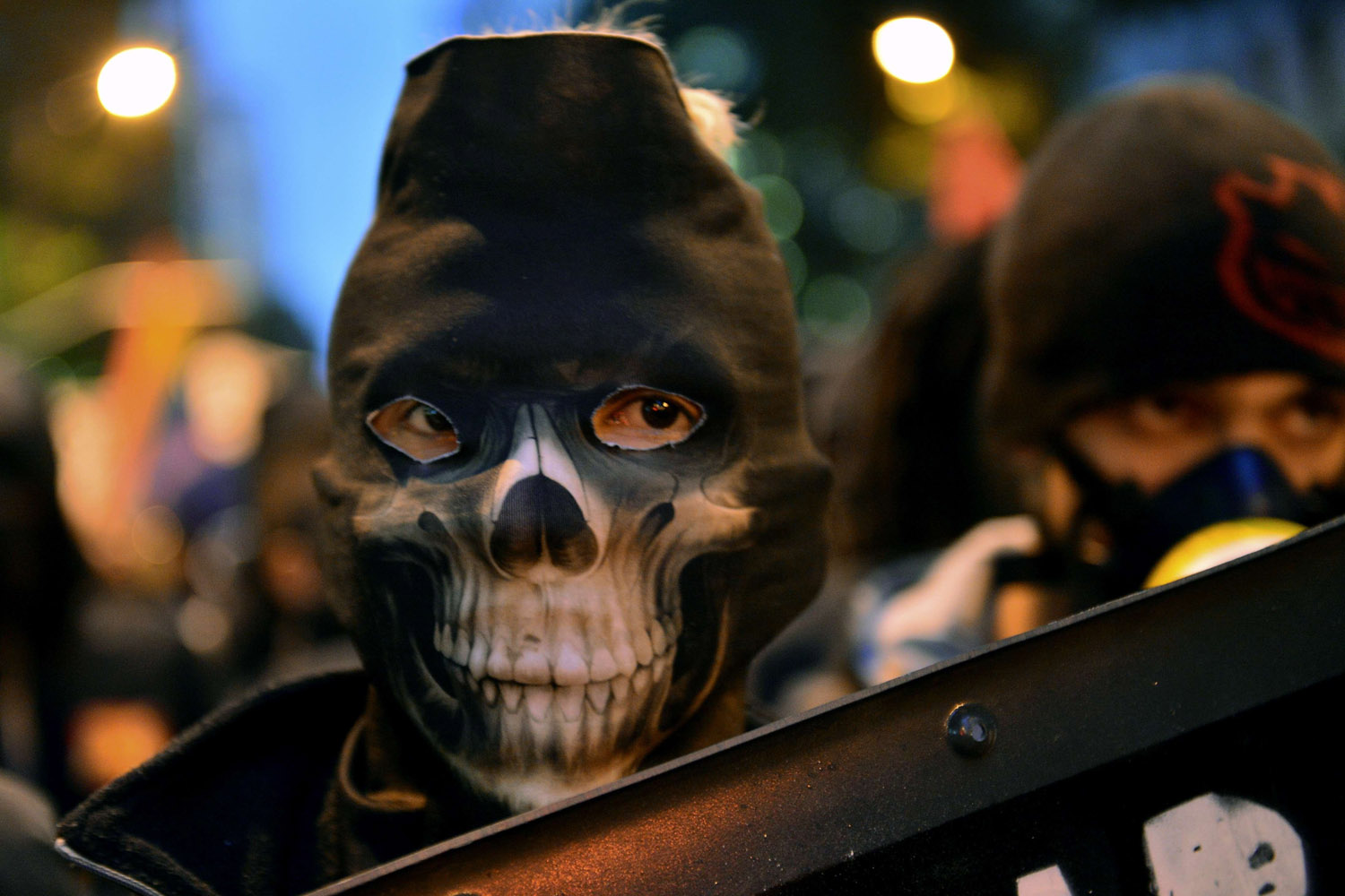 Oct. 7, 2013. A demonstrator marches during a teachers protest demanding better working conditions and against police beating in Rio de Janeiro.