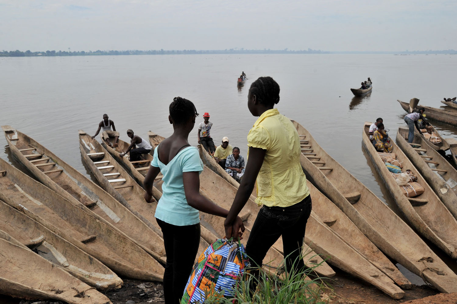 Oct. 10, 2013. People prepare to cross by boat the Oubangui River to reach the Congolese city Zongo.