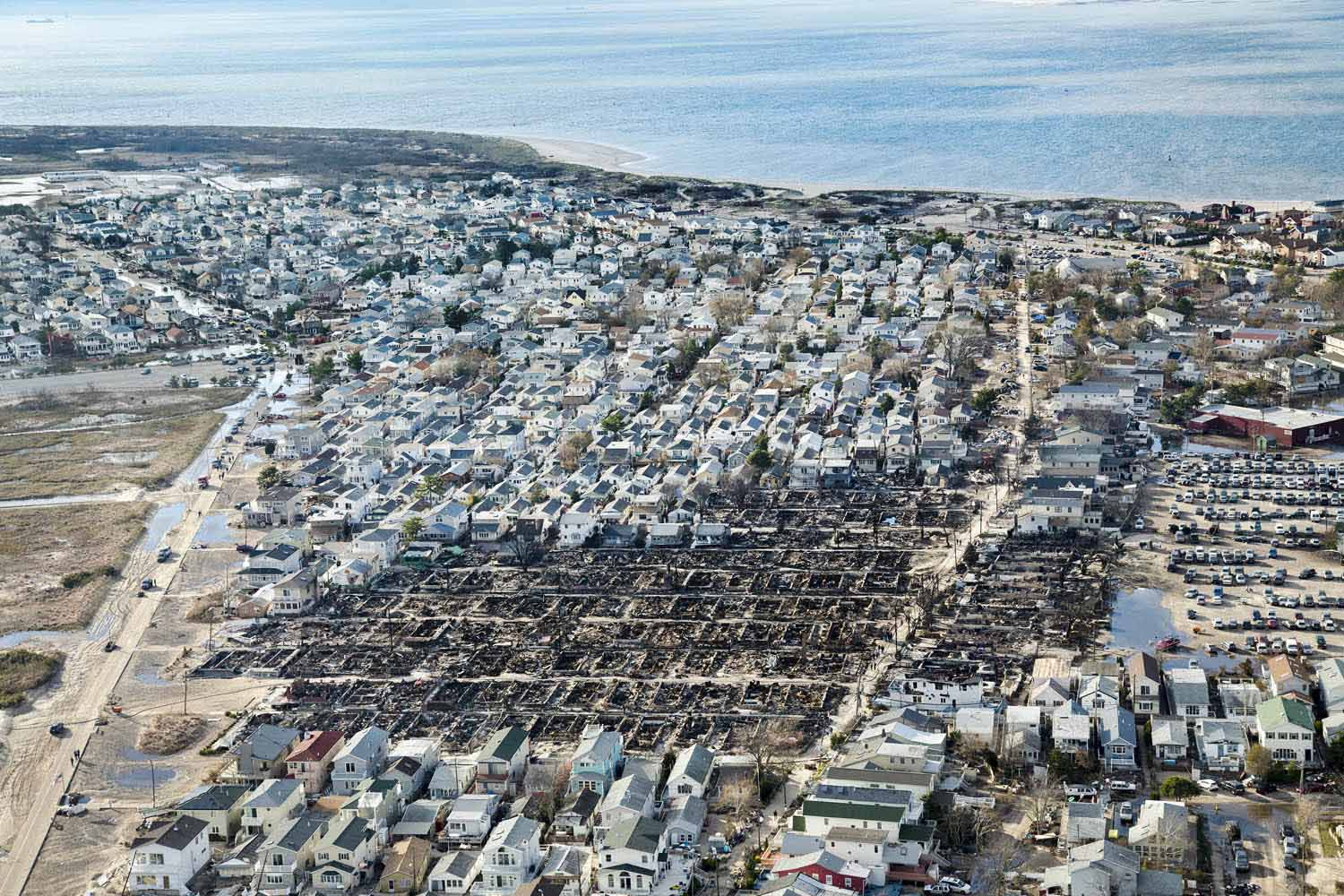 On the night Sandy made landfall, a fire swept through this community on the tip of the Rockaway Peninsula, consuming more than 100 homes, Breezy Point, N.Y., 2012