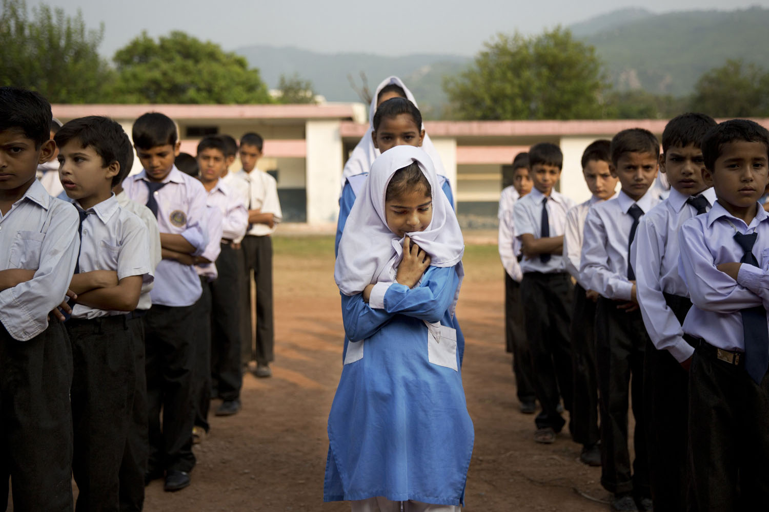 Oct 11, 2013. A Pakistani girl lines up among boys for their morning assembly where they sing the national anthem at a school in Islamabad, Pakistan.