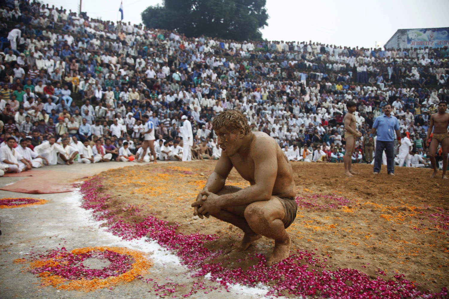 Oct.10, 2013. England's Lubchik Dacenko, rests after defeating Indiaís Bhalu during an annual wrestling championship at Mathwar village near Jammu, India,