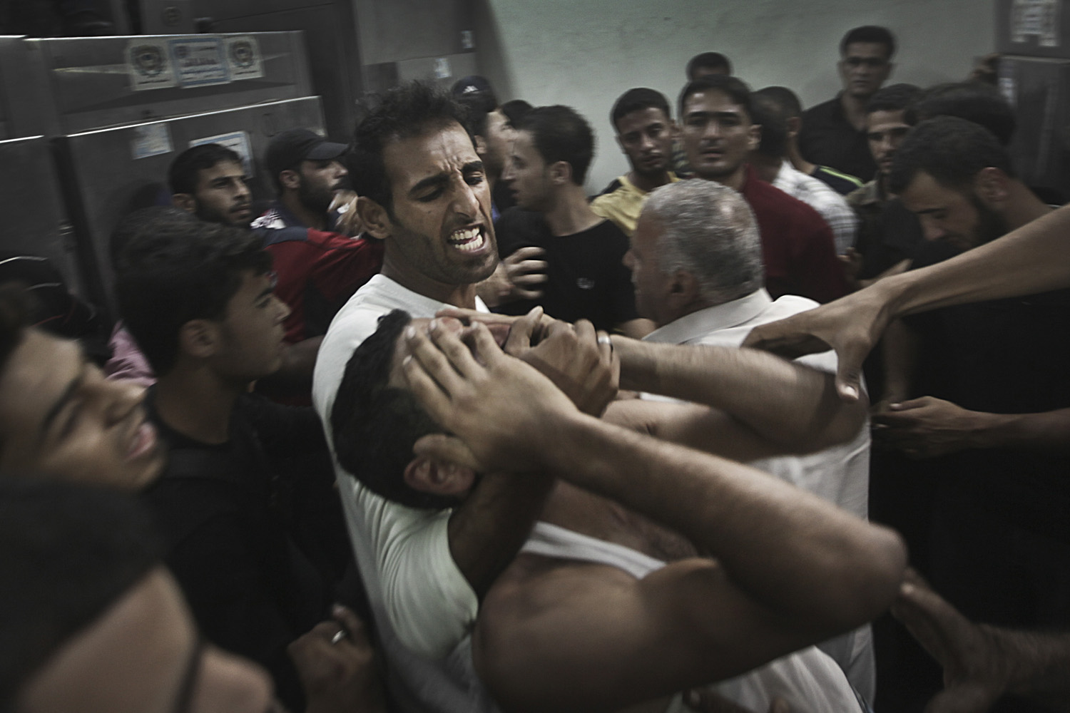 A Palestinian man reacts to the death of his relative, one of two Palestinian militants killed in an Israeli air strike in Kamal Edwan hospital morgue in Jabaliya Refugee Camp in northern Gaza Strip. Oct. 24, 2012.