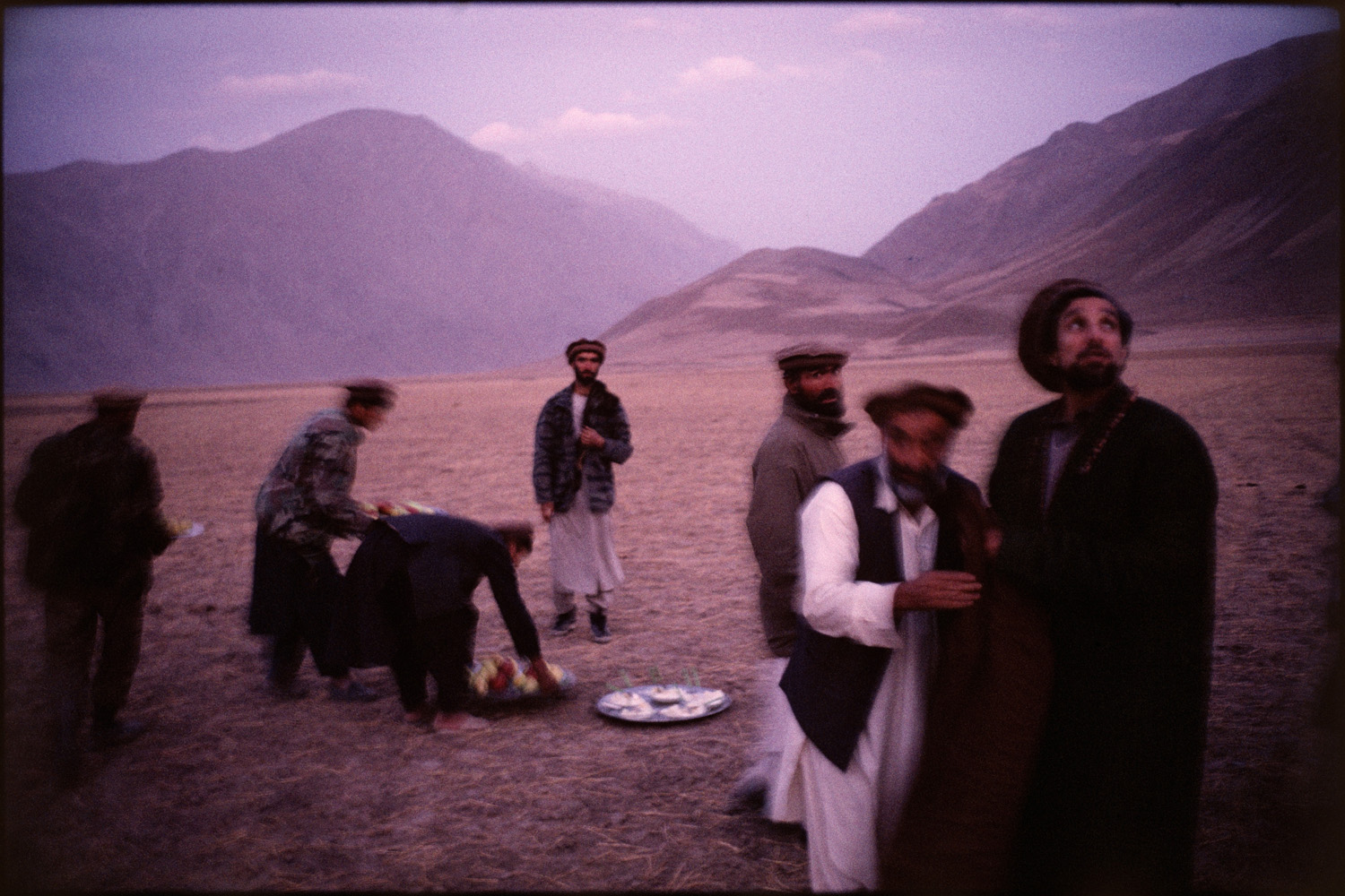 Massoud and friends near Faizabad, Badahkshan Province and the moment is captured following a an early evening prayer session in a fruit orchard. November 1998.