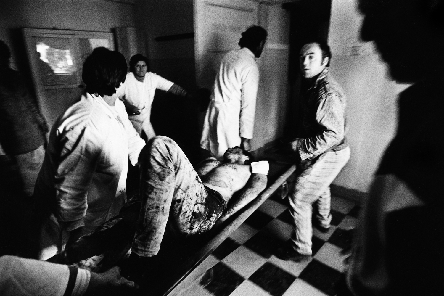 A wounded rebel is brought into the hospital in Vlora, Albania. He was hit in a short exchange of gunfire between government forces and rebels near the bridge between Vier and Vlora.                                                                                              (WPP 1st prize, People in the News stories, 1997)