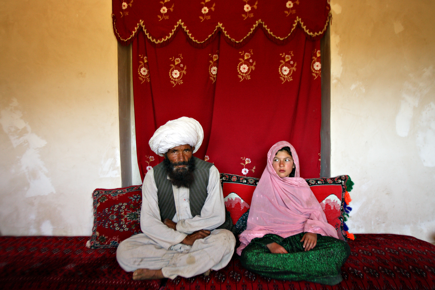 Faiz, 40, and Ghulam, 11, sit in their home prior to their wedding in rural Afghanistan. Sept. 11, 2005.                                                                                             (WPP 1st prize, contemporary issues/ stories , 2012)