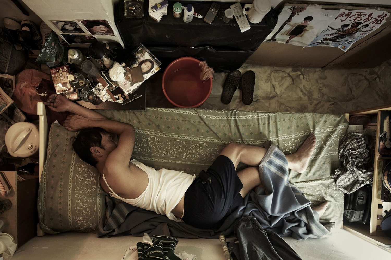 Feb. 22, 2013. A man in his apartment in Hong Kong.