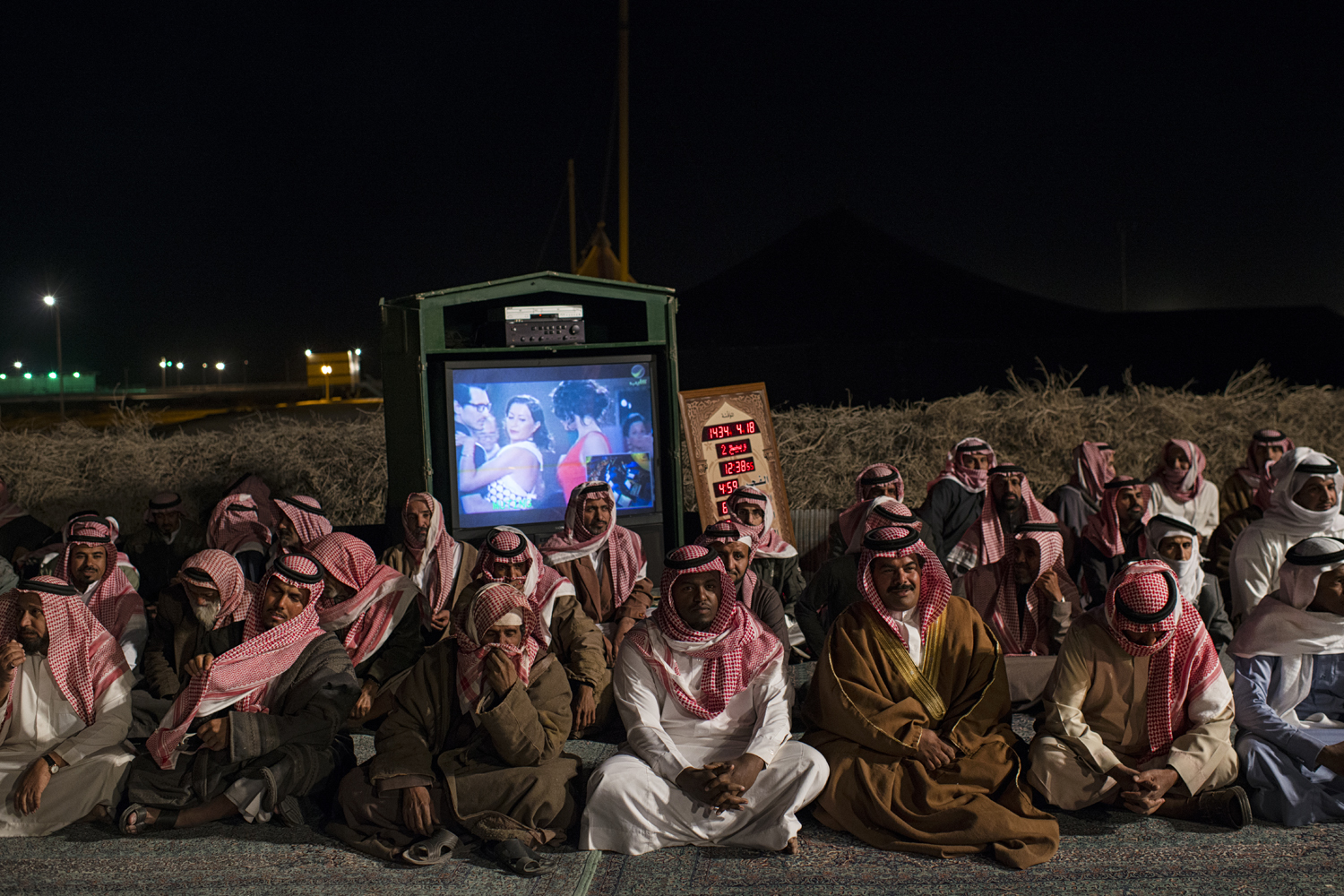 March 1, 2013. Saudi citizens rest after presenting Saudi billionaire HRH Prince al Waleed bin Talal with petitions for his help, at a desert camp outside of Riyadh, Saudi Arabia.