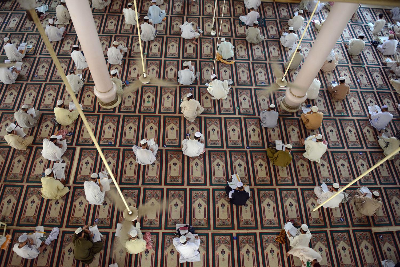 March 16, 2013. Islamic religious students take mid-term exams at Jamia Binoria, the nation's largest Islamic seminary in Karachi, Pakistan.