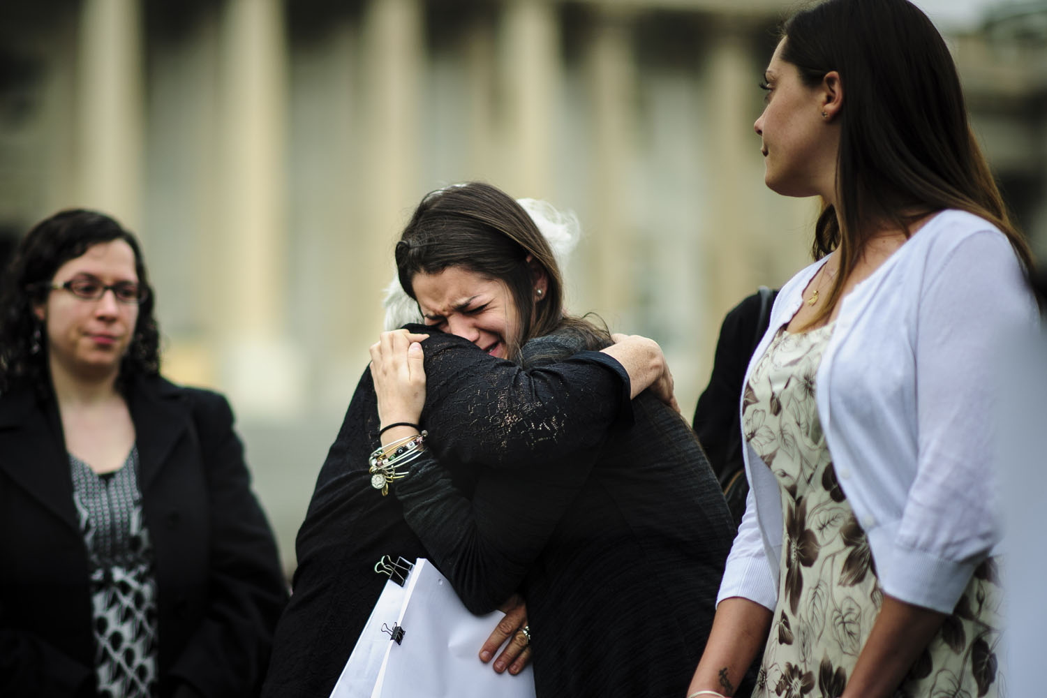 April 16, 2013. Carlee Soto, sister of Victoria Soto, a teacher killed at the Sandy Hook Elemenatry School, is overcome during a vigil outside of the U.S. Capitol.