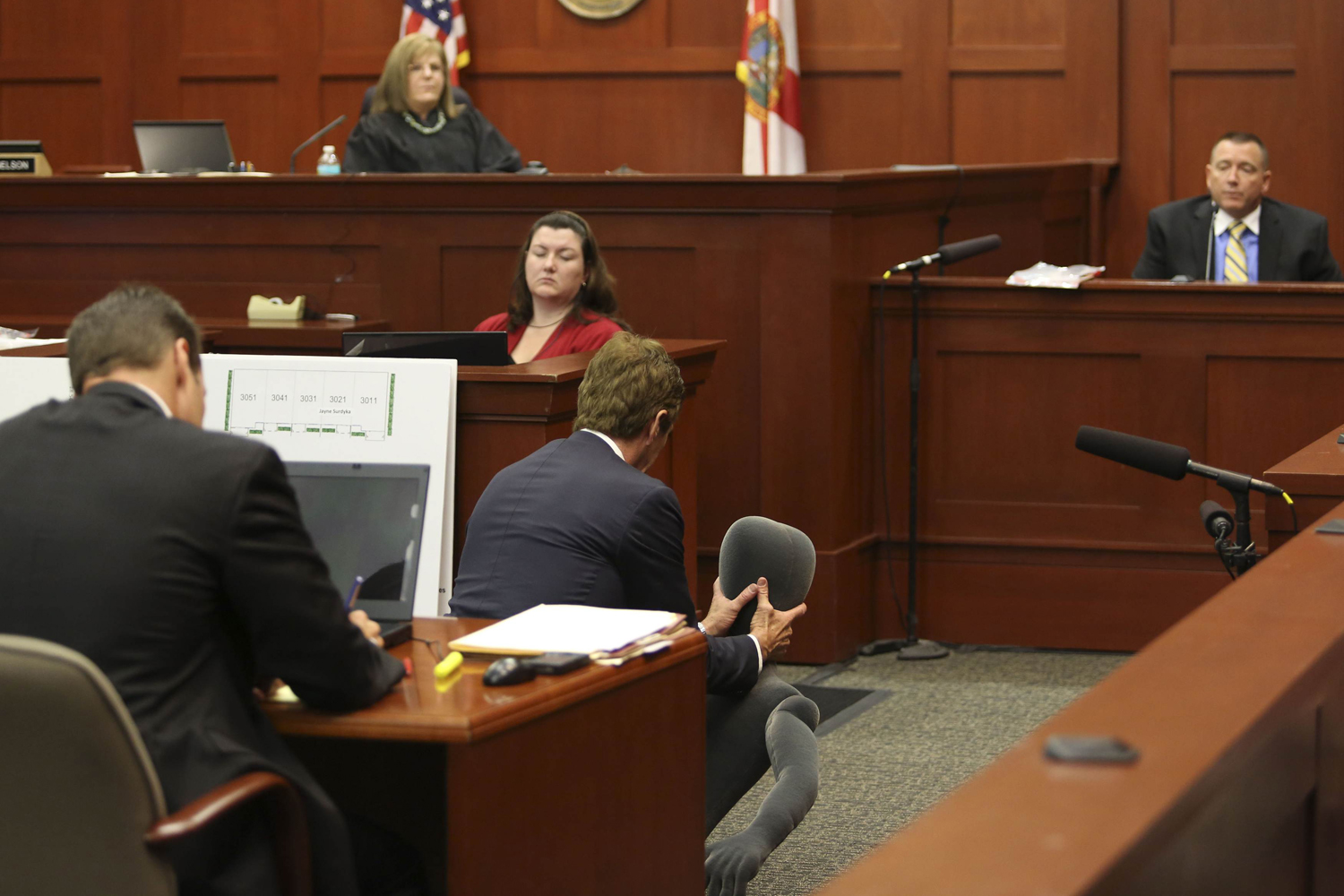 July 10, 2013. Defense attorney Mark O'Mara uses a foam dummy to describe the altercation between George Zimmerman and Trayvon Martin to defense witness and law enforcement expert Dennis Root  (R) during Zimmerman's trial in Seminole circuit court in Sanford, Fla.