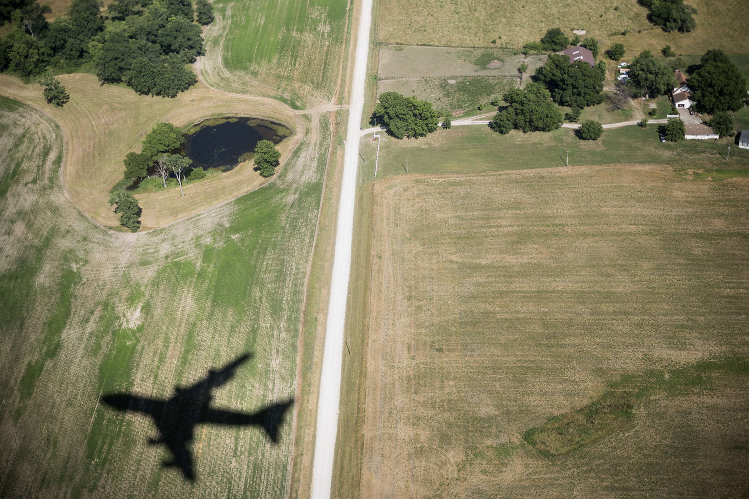 July 24, 2013. Air Force One's shadow is seen while flying over Knob Noster to Whiteman Air Force Base in Missouri.