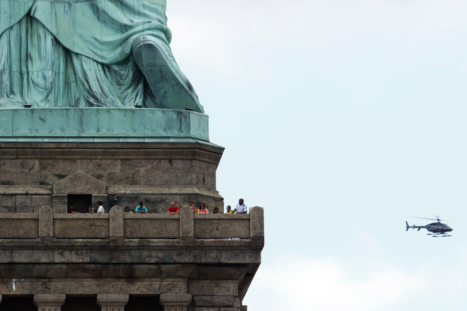 July 4, 2013. People visit the Statue of Liberty during the reopening ceremony in New York. Under steamy summer skies, tourists in New York flocked to ferries headed for the Statue of Liberty, re-opening with an Independence Day ceremony after closing in October as Superstorm Sandy approached.