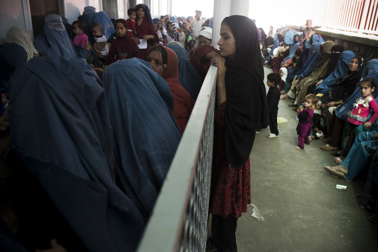 Aug. 19, 2013. Women wait for services at the Ahmed Shah Baba Hospital in Kabul.
