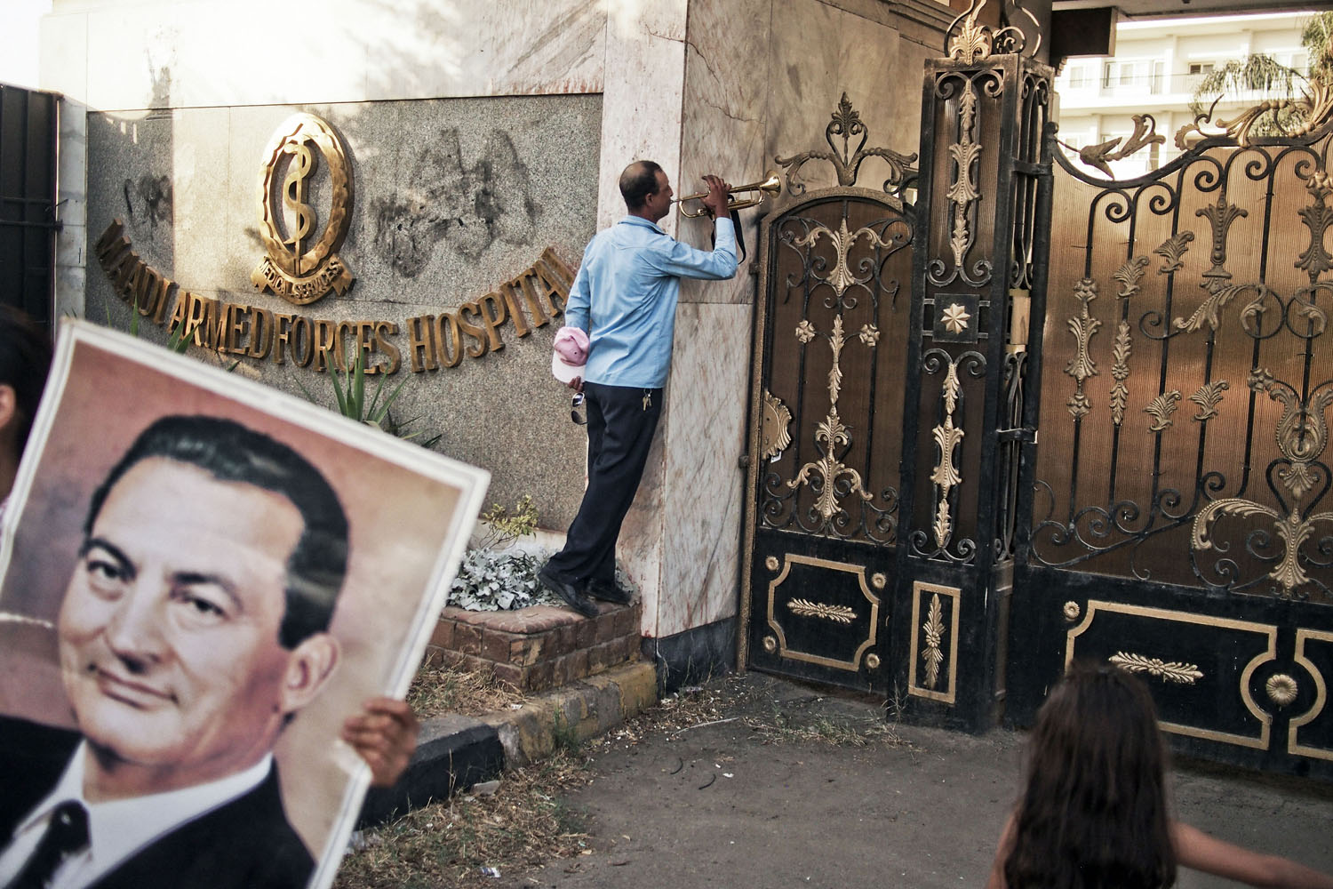 Aug. 22, 2013. A supporter of former Egyptian President Hosni Mubarak plays the trumpet at the gates of the Maadi Military Hospital where Mr. Mubarak was admited after being released from Tora Prison on the outskirts of Cairo.