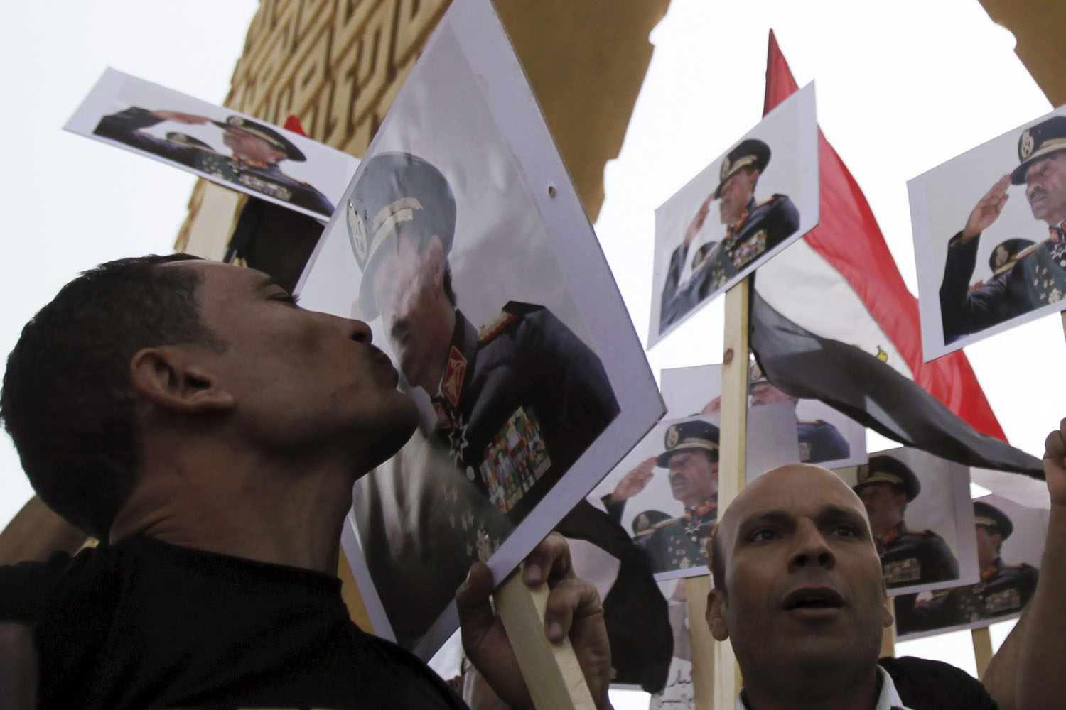 Oct. 6, 2013. A man kisses a poster of late Egyptian President Anwar Sadat as supporters of army shout slogans against ousted Islamist President Mohamed Mursi and members of the Muslim Brotherhood at Sadat's tomb, during the 40th anniversary of Egypt's attack on Israeli forces during the 1973 war, at Cairo's Nasr City district.
