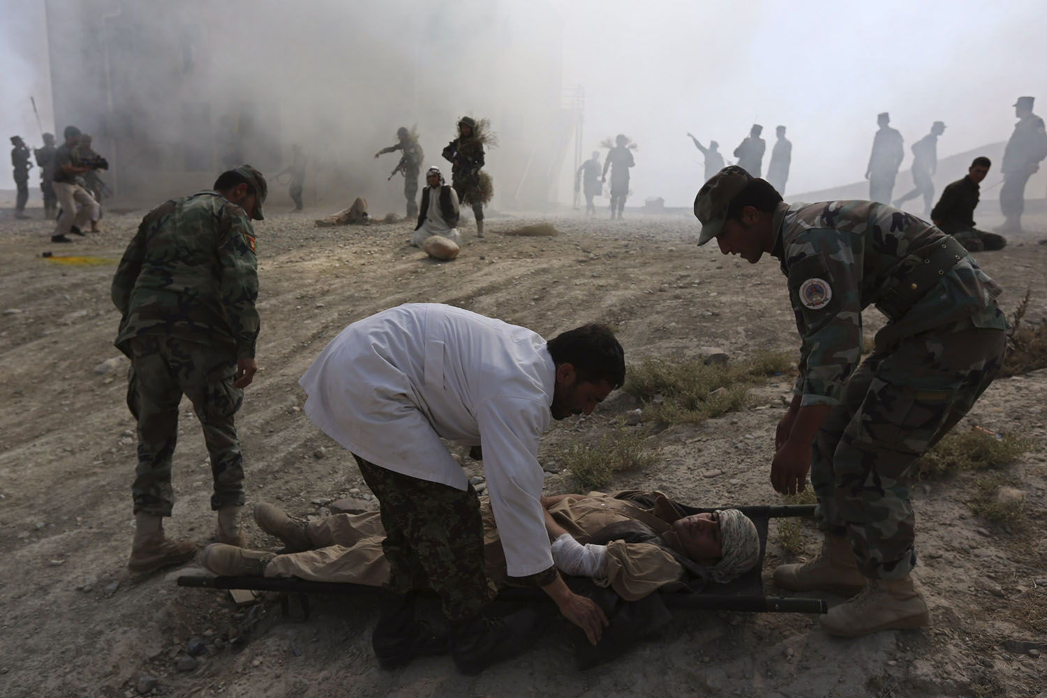 Oct. 8, 2013. Afghan National Army officers take part in a training exercise at the Kabul Military Training Center in Kabul.