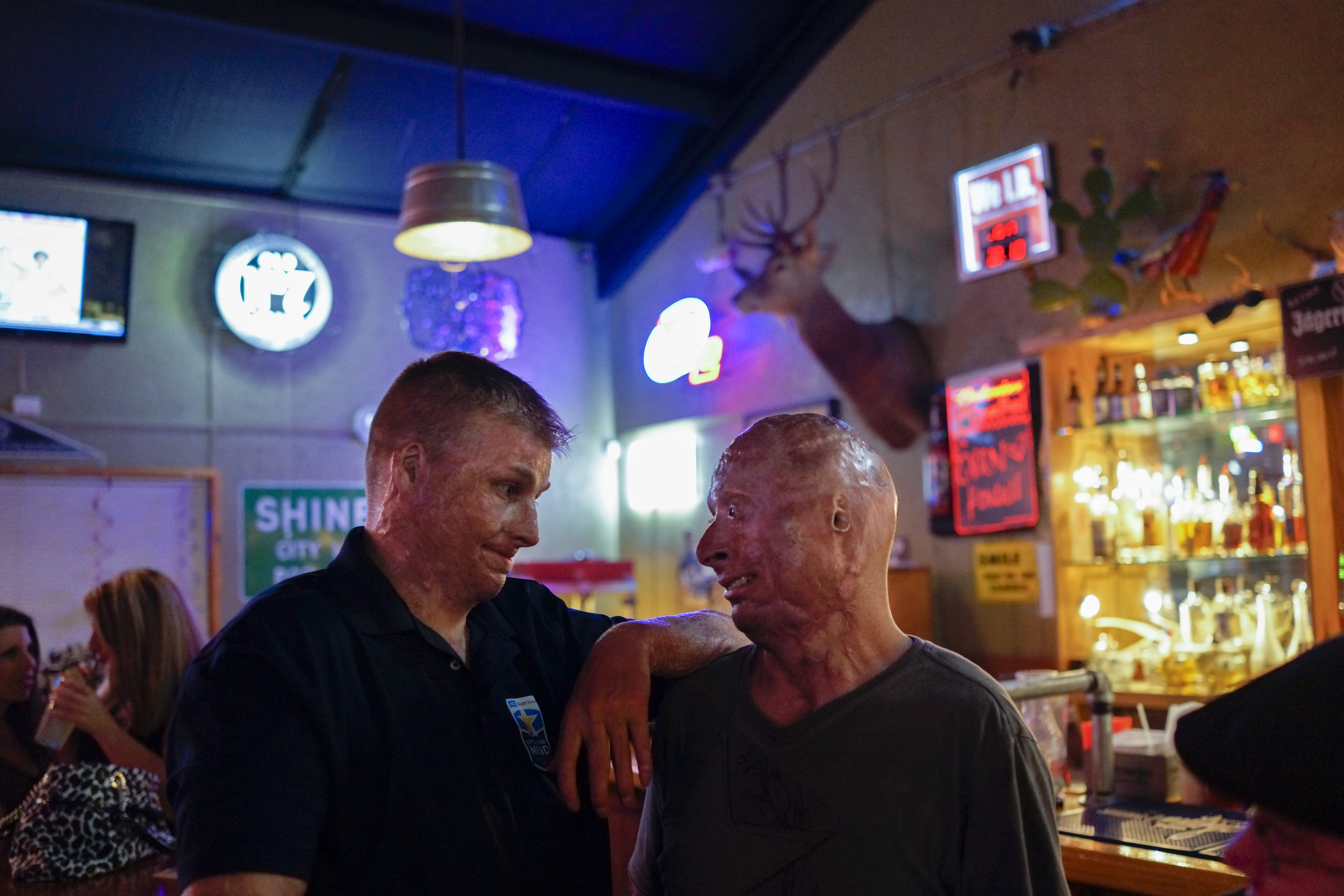 With a fellow burned service member at the Bracken Saloon after his weekly comedy routine. San Antonio, Texas, 2013.